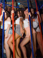 Party Girls Dancing in a Cage