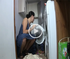 Upskirt Fun as she loads the washing machine