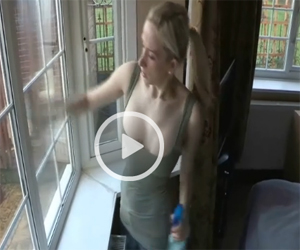 Fiona Shows Cleavage as she Cleans the WIndows