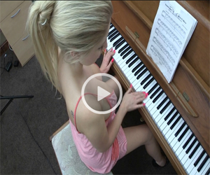 Georgie Playing the Piano for Downblouse Loving